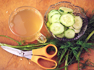 Cutting Board with Scissors, Dill, Pickling Liquid, and Sliced Cucumbers