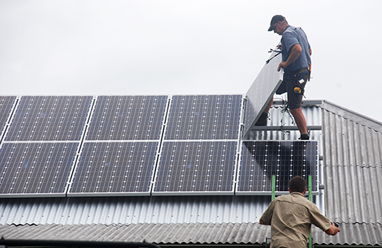 installing solar panels on a tin roof