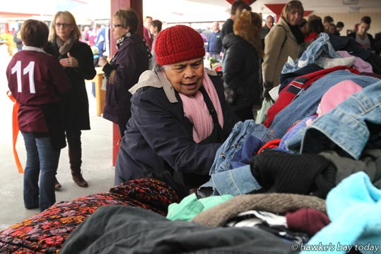 Latai Tuanaki, Flaxmere, Hastings, looking through the jumble sale at a gala at St John's College, Hastings. photograph