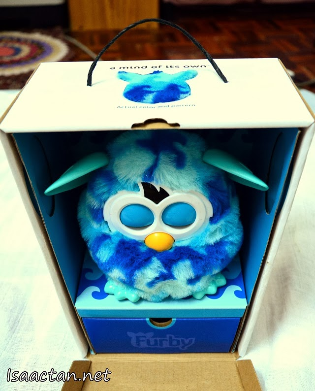 "Open the front cover and you'll see Furby ""sleeping"" in the box"