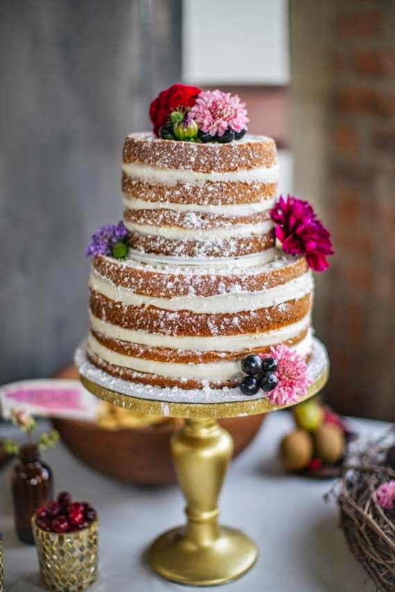 naked wedding cake with spring flowers