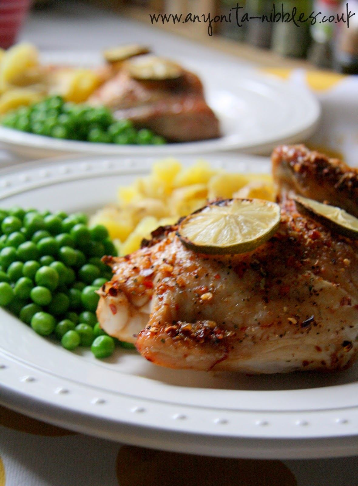Two plates of peri-peri chicken dinner from www.anyonita-nibbles.co.uk