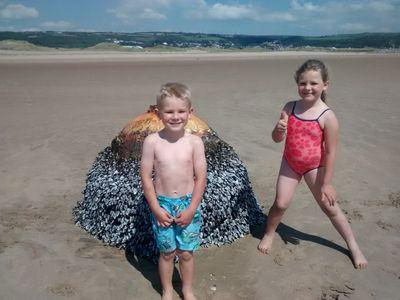 Family photographs kids with 'beach buoy', turns out it was WWII bomb