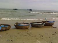 Barcos de pescadores redondos Vietnamitas Thung Chai