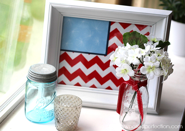 An old frame, some spray paint and some scrapbook paper are all you need to make this patriotic USA Flag Picture Tray!