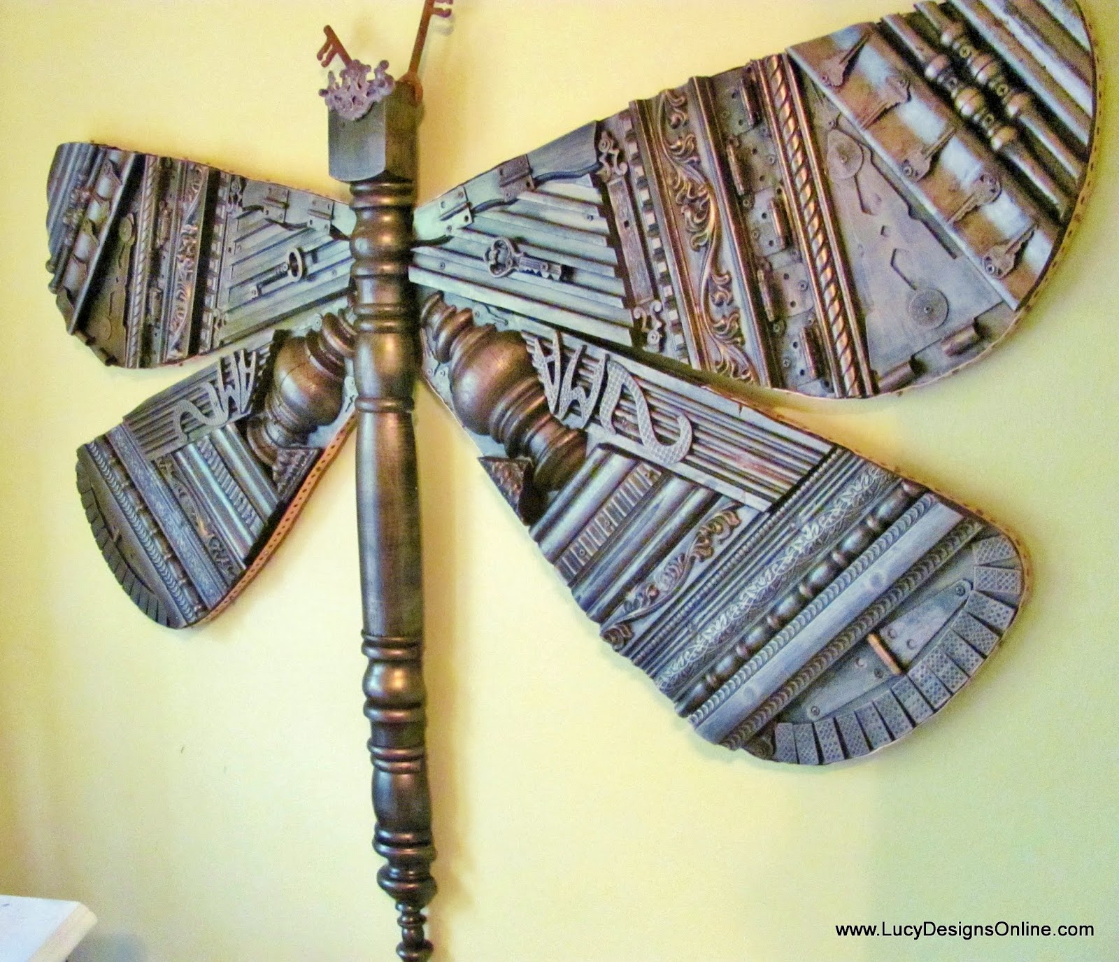 dragonfly recyled art sculpture from repurposed picture molding