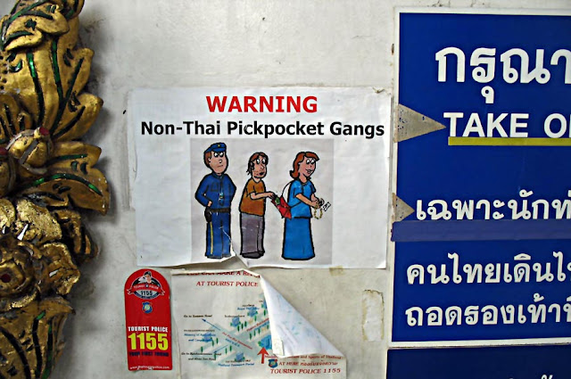 warning sign at Thai airport