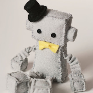 robot plush with top hat and bow tie