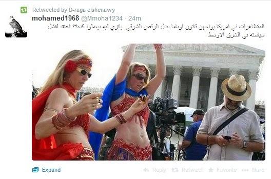 متظاهرات أمريكيات يواجهن أوباما بملابس الرقص الشرقي