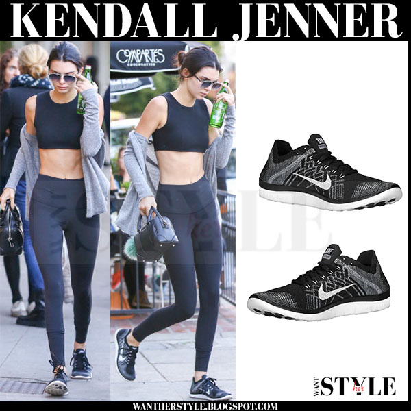 Kendall Jenner in black crop olcay gulsen top, black lululemon leggings and black nike flyknit sneakers what she wore
