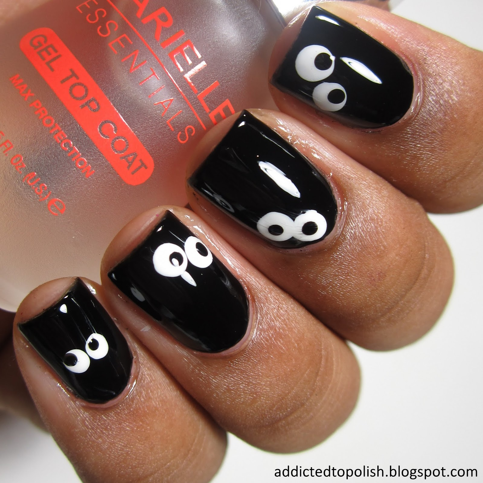 spooky-googly-eyes-in-the-dark-halloween-nail-art