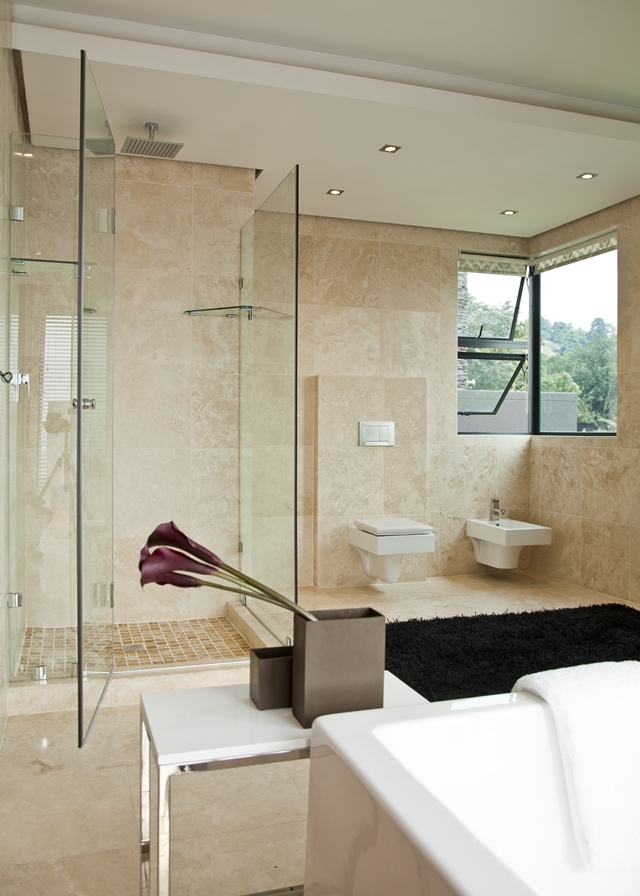 Picture of modern shower cabin and black carpet on the floor in the bathroom