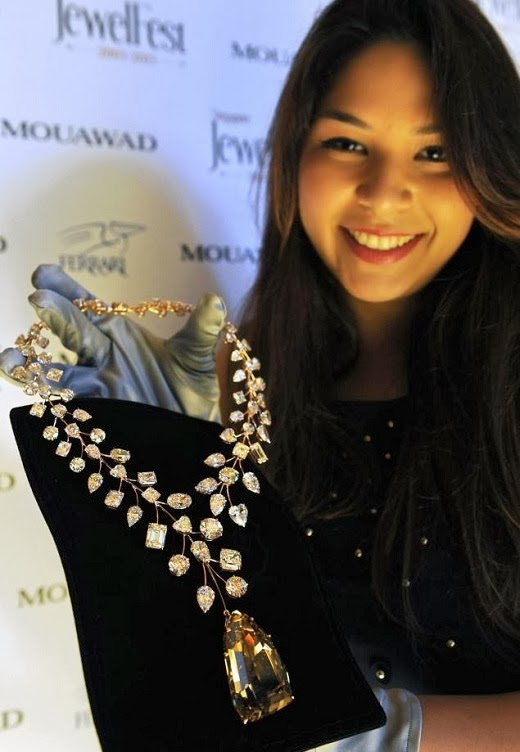 Jessica Nasr, a staff member of Dubai-based jewellery with necklace