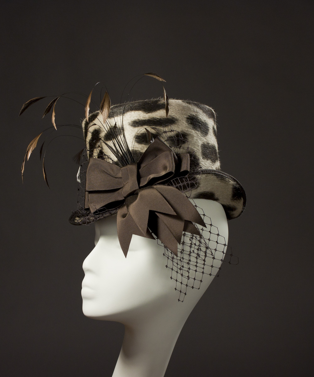 cd1e368cbc44 ... in a brown and tan leopard print, and chocolate brown ribbon trim,  vintage veiling, and feathers. The veiling is carefully dagged and the  feathers were ...