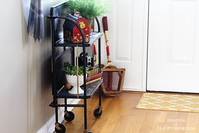 Looking for something different for the hallway?  Kick traditional decor to the curb and go for a vintage eclectic look for the entry hallway.   via houseofhawthornes.com