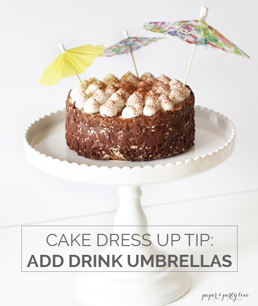 Dress up a store bought cake with drink umbrellas