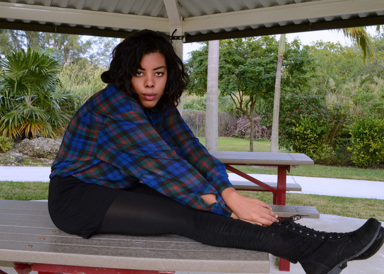 Fashion Blogger Anais Alexandre of Down to Stars in a vintage plaid button-down and Forever 21 black combat boots and leather leggings