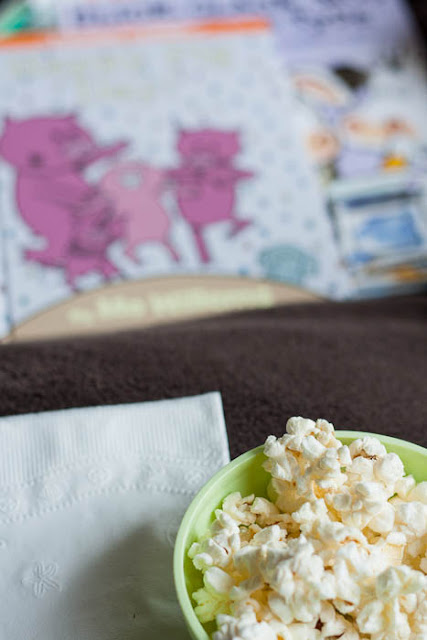 bowl of popcorn and picture books