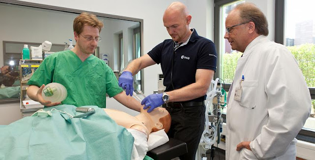 Alexander Gerst practising intubation to ventilate the lungs and prevent obstruction of the airway. A flexible plastic tube is inserted into the windpipe to maintain an open airway or to serve as a conduit for administering drugs. Credit: ESA