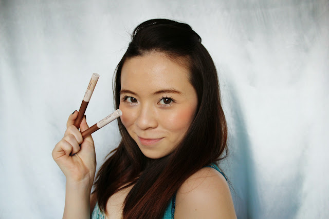 girl holding glitter liners