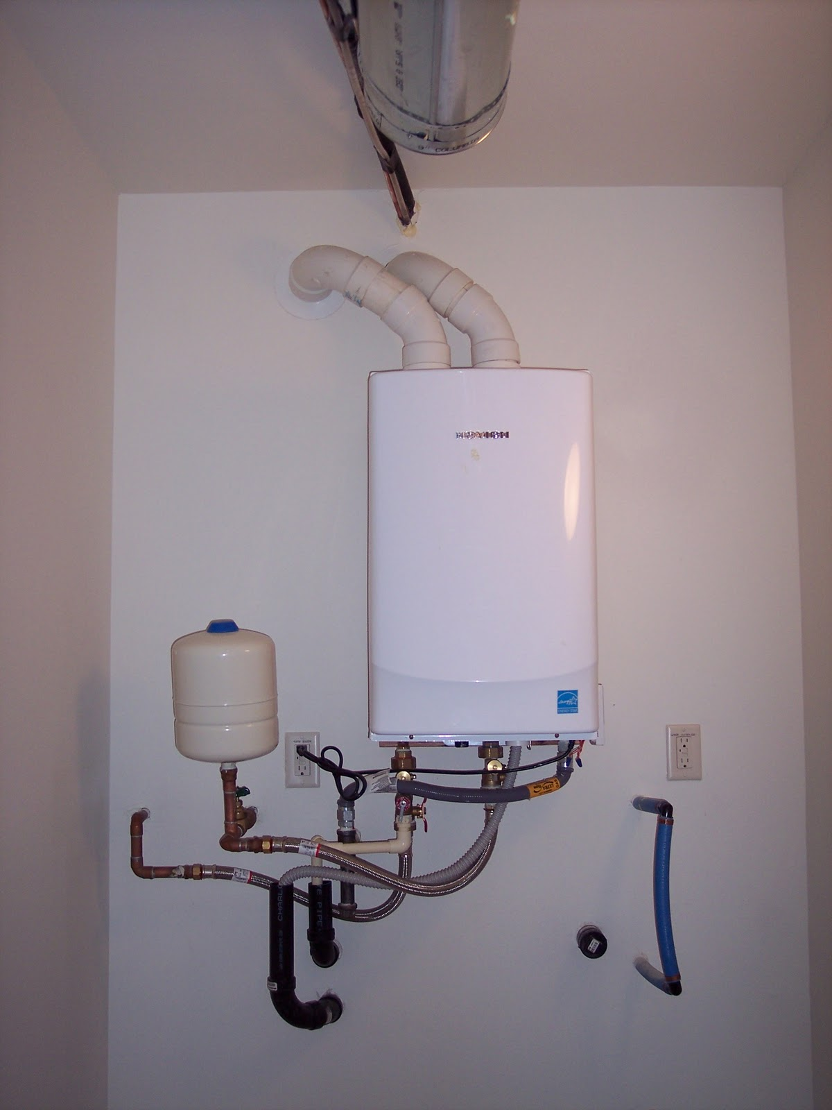 Navien Tankless Water Heater Venting : Building a home water collecting under wall below navien