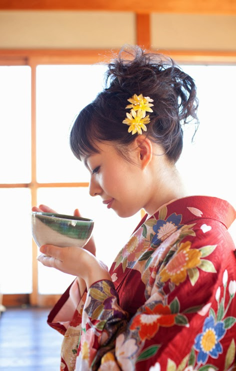 Japanese woman in kimono drinking Matcha tea