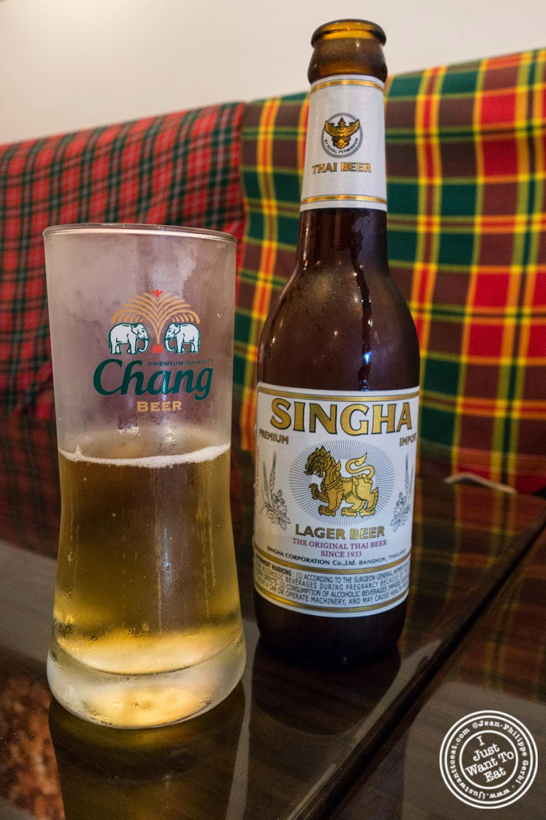 image of singha beer at Larb Ubol, Thai restaurant in Hell's Kitchen, NYC, New York