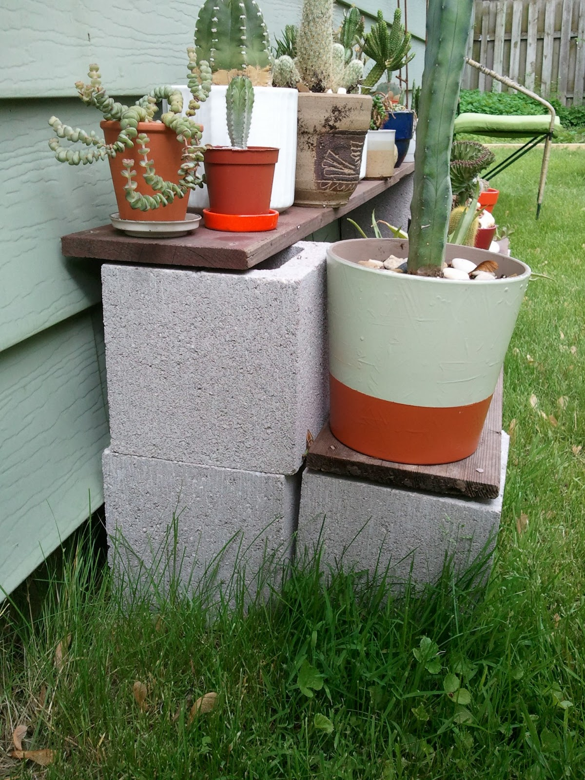 Modern day moving outside for Cinder block plant shelf
