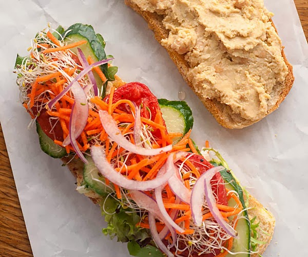 lemony hummus sandwich with cucumber  radish sprouts  and