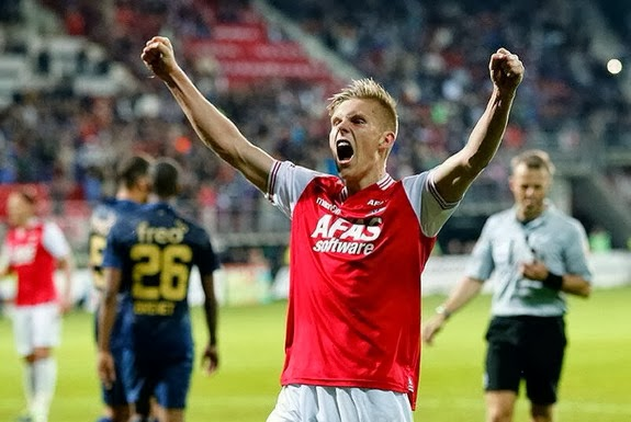 AZ Alkmaar player Aron Jóhannsson celebrates after scoring the winning goal against PSV