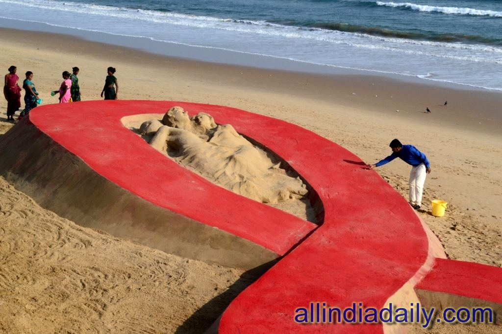 Sand sculpture at Chandrabhaga beach of Konark, Odisha on world Aids Day