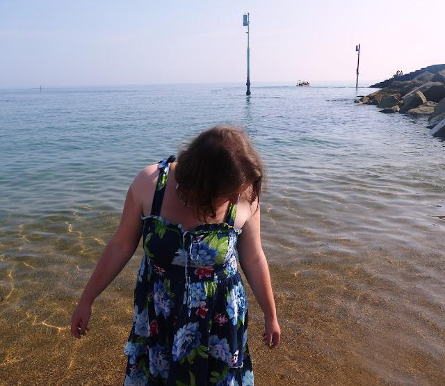 Girl in Dress Paddling in the Sea