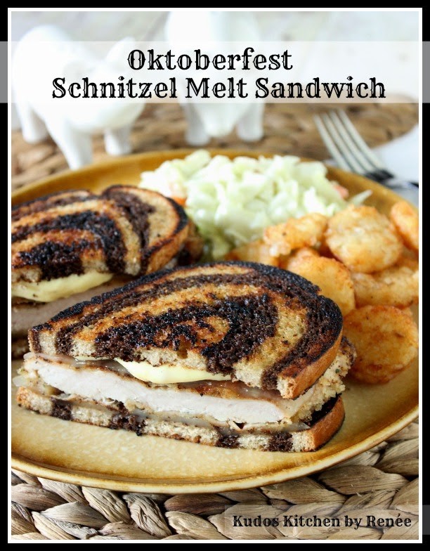 Pork schnitzel with Swiss cheese and honey mustard mayo on marbled rye bread.