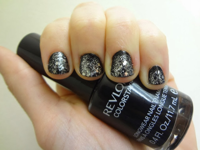 Black nail polish with silver glitter