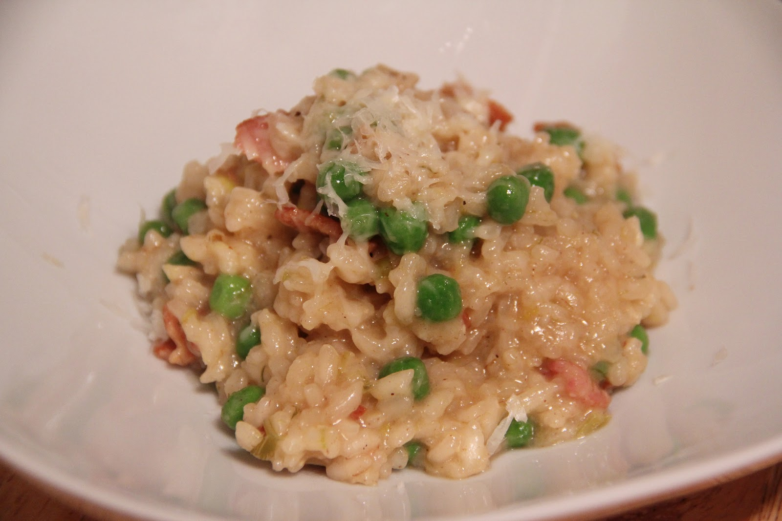 bacon, delicate onion-y leeks and plump green peas make this a risotto ...