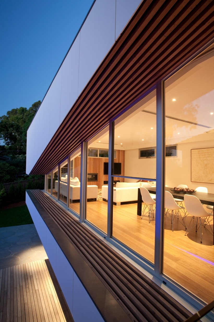 Glass wall on the upper floor of Kew House by Vibe Design Group