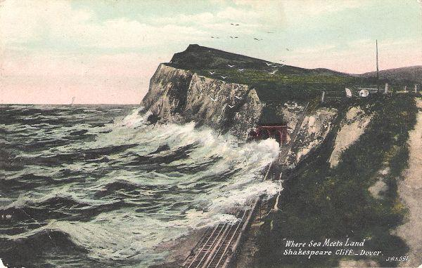 coloured vintage postcard of Shakespeare Cliff and railway line running alongside the sea