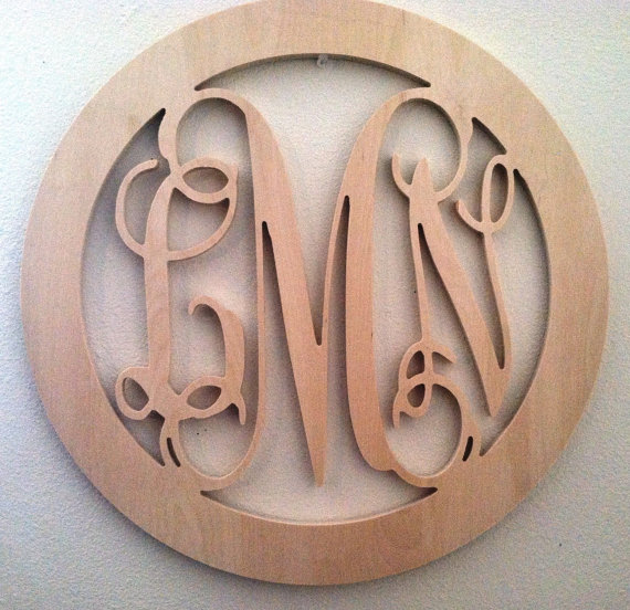 the 18 inch circle border wooden monogram letters are lovely the center letter is cut 18 inches tall the overall width measures18 inches