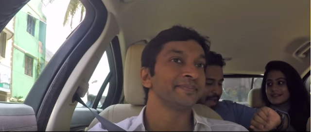 Ola cabs has released a promo video featuring Formula One driver Narain Karthikeyan.   Imagine hailing an Old cab and you see Narain Karthikeyan in the driver's seat. He is also accompanied by Some Mathew, a self-anointed You Tube comedian.