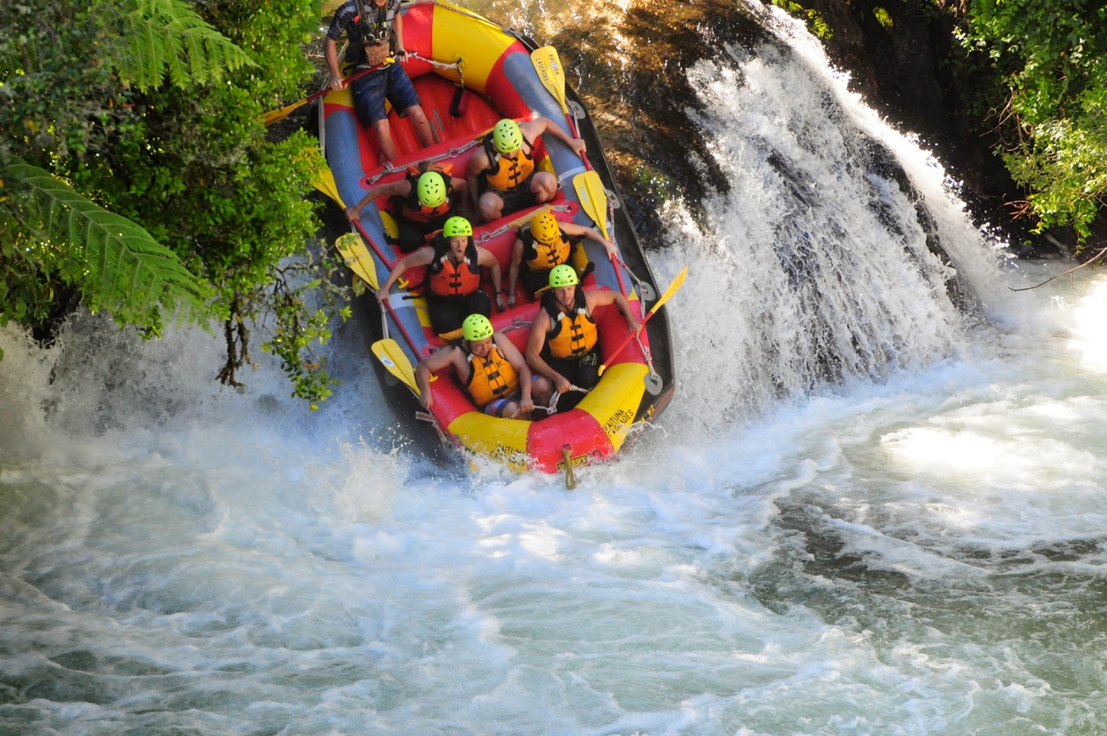 Overcoming the first waterfall - white water rafting in Rotorua, New Zealand