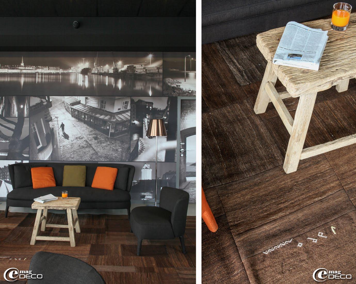 Dans le salon de l'hôtel Best Western Balmoral à Saint-Malo, canapé et fauteuil 'Maxalto' dessinés par Antonio Citterio et vieille table asiatique sur des patchworks de tapis anciens réalisés avec des dos de sacs de grains