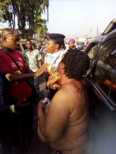 Image result for Mob strips female Kidnapper in Lagos