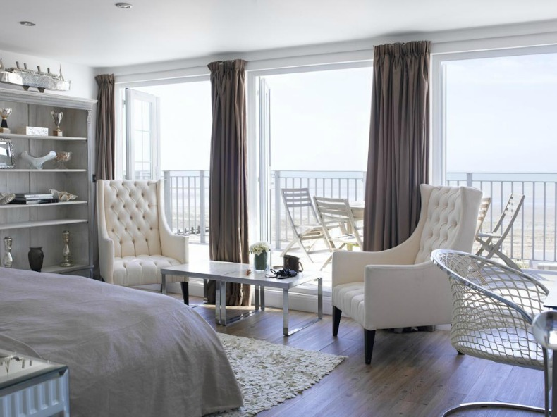 Coastal master bedroom with ocean view