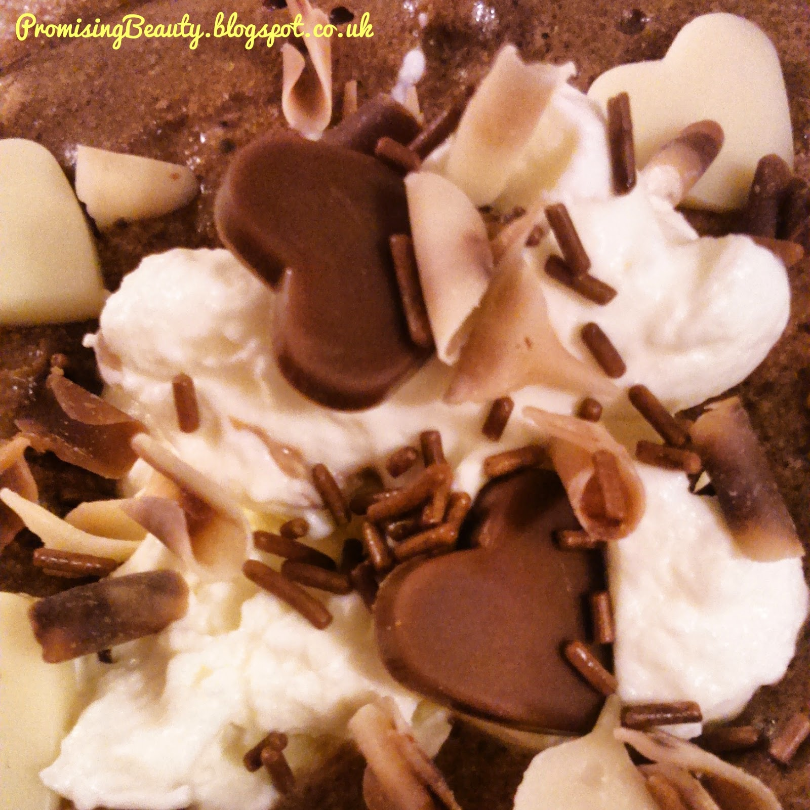 chocolate mousse topping, whipped cream, chocolate sprinkles, chocolate hearts. Yummy dessert
