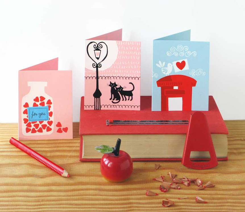 still life with valentines cards and red things