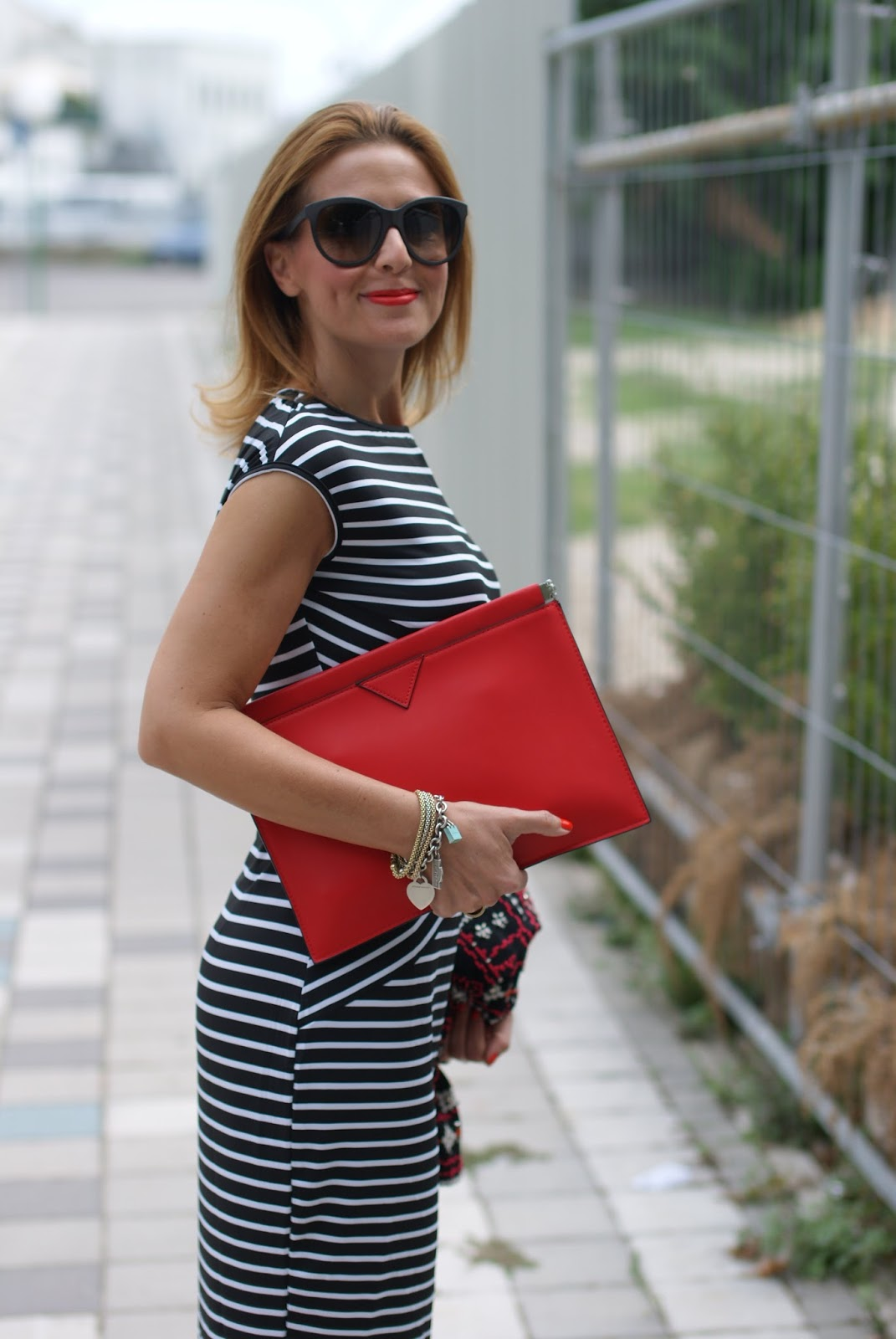 Choies striped bodycon midi dress worn with Zara red clutch and embroidered jacket and adidas Stan Smith Rita Ora sneakers on Fashion and Cookies fashion blog
