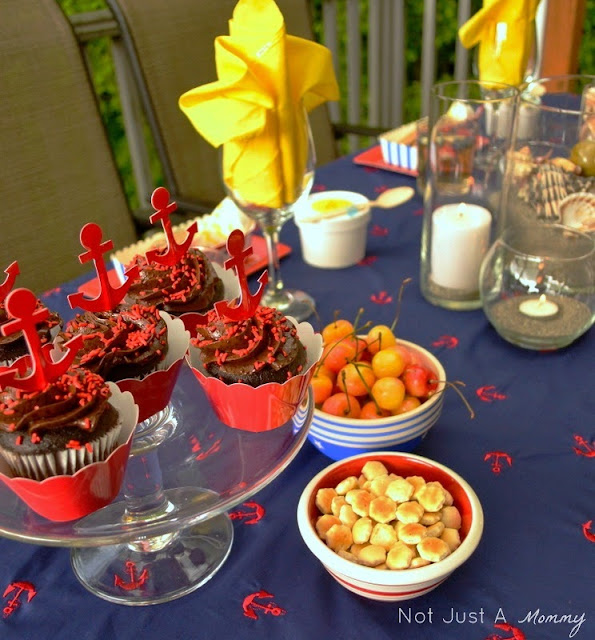 Starfish And Stripes: Nautical 4th Of July Tablescape anchor cupcakes