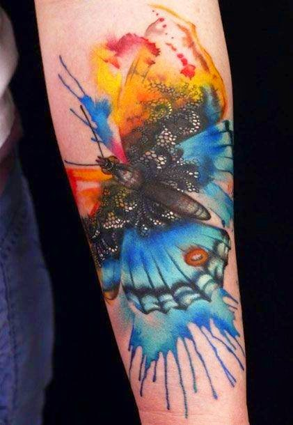 Watercolor butterfly tattoo on arm