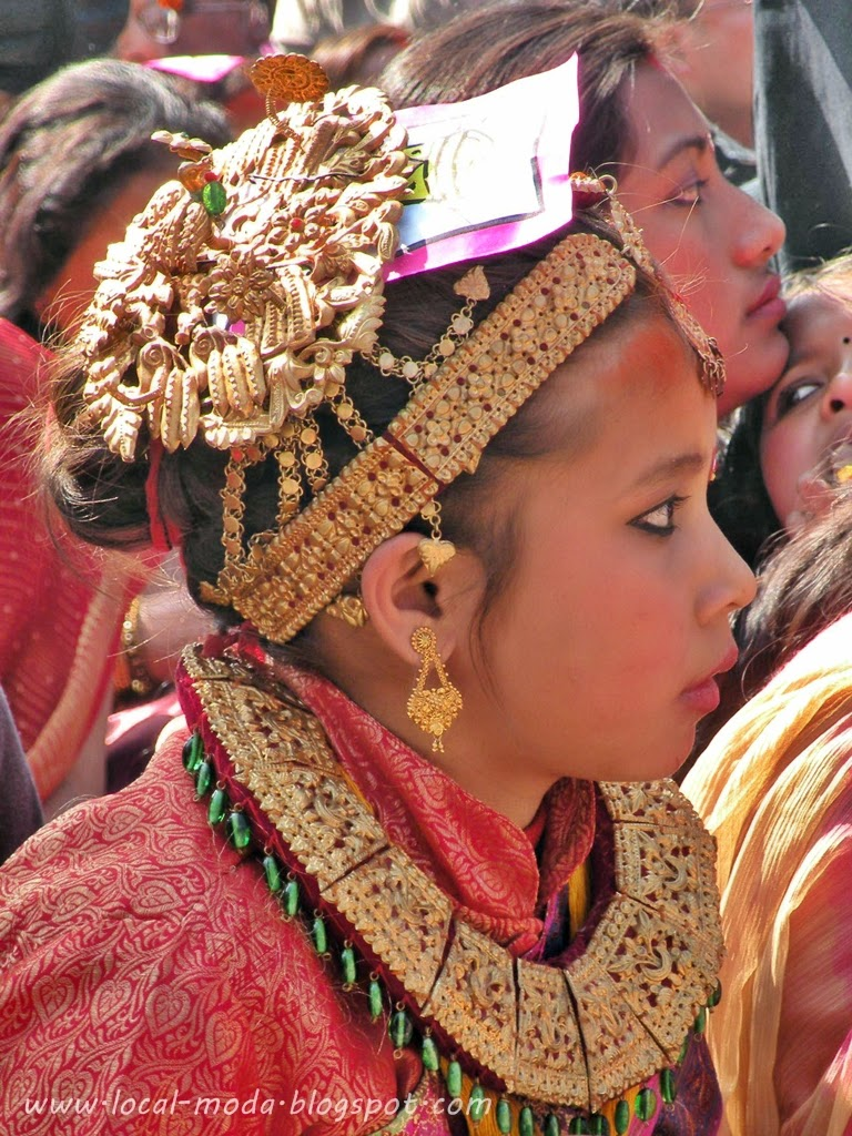 Nepali Newari girl wearing traditional necklace and head ornament