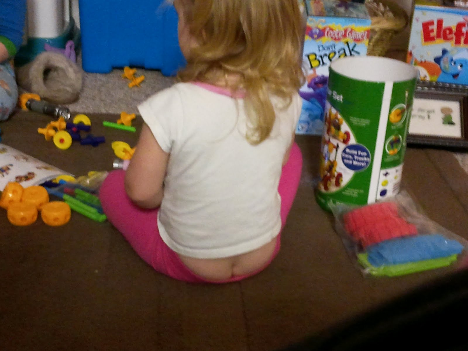 little girl but crack Her butt crack is always always always hanging out. I think its because she  has a high butt crack. I still think it is so cute anyways.